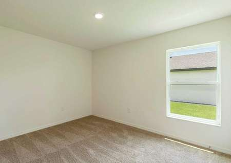 Carpeted spare room of the Anastasiafloor plan with a large window and a light fixture on the ceiling.