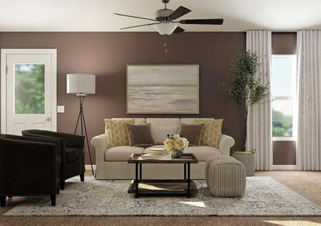 Rendering of living   room with ceiling fan, window and door to back yard decorated with a   cream-colored couch and two black accent chairs