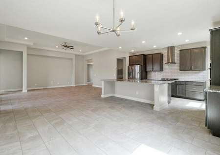 Hawley great room with five-candle chandelier, ceramic flooring throughout, and brown kitchen cabinetry