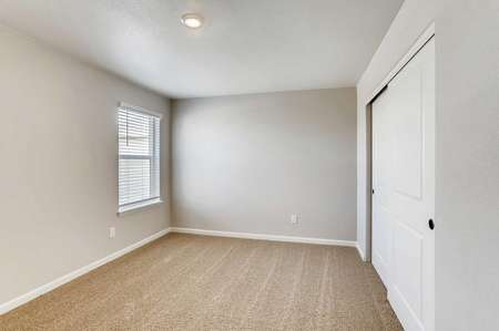San Juan bedroom with ceiling light, window with blinds, and brown carpet