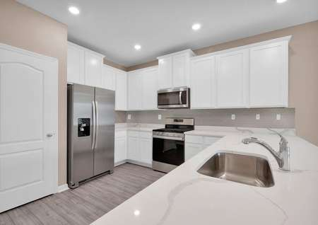 All new kitchen appliances, quartz countertops and recessed lighting come included in this floor plan.