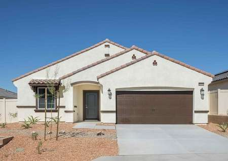 Balboa single-family home with brown garage door, desert landscaping, white paint with brown highlights