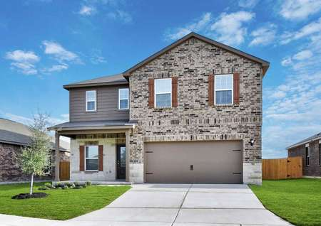 Camden finished single family house with two levels, brick finish, and brown garage door