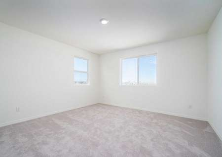 Redondo bedroom with recessed light, two white frame windows, and soft brown carpet