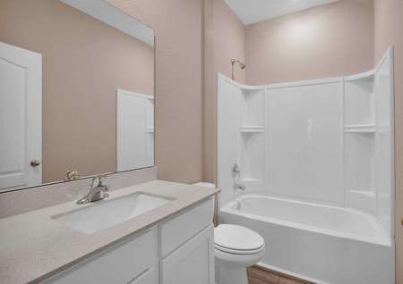 Great countertop space is found in the guest bathroom in the Halifax home.