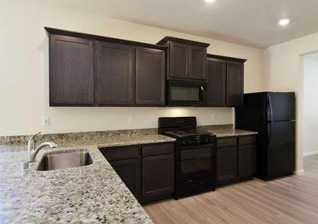 Columbia kitchen with granite counters, undermount sink, and brown cabinets