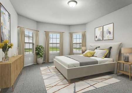 Cypress bedroom with modern grey bed with grey and white beddings, house plant with white vase, and two pictures hanging on the wall