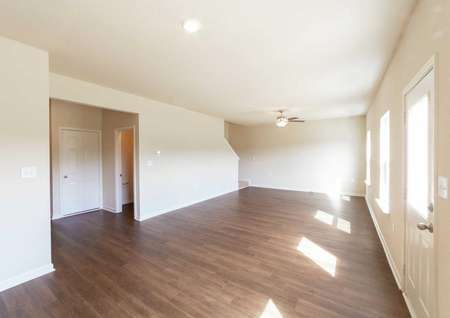 Spacious living room with ceiling fan in the Hartwell model