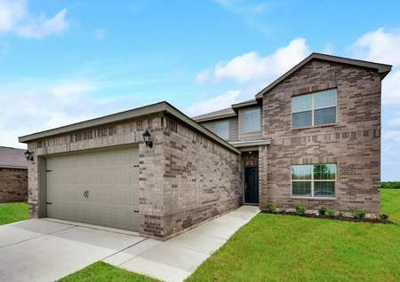 The Oakmont has a covered front entryway and professional front yard landscaping.