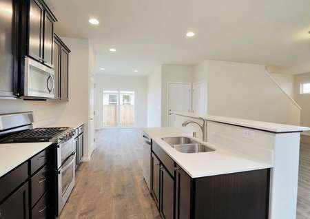 Fox kitchen with recessed lights, granite countertops, and brown cabinets