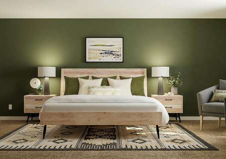 Rendering of spacious master bedroom with   large wooden-frame bed, matching nightstands and two gray chairs