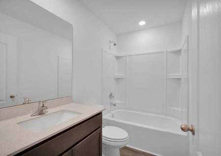 A full bathroom in a brand-new home.