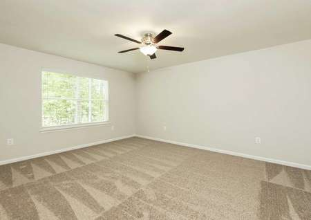 The Mid Atlantic Conway showing another view of the master bedroom with a decorative ceiling fan and faux wood blinds.
