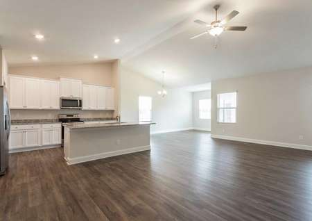 Burton open floor plan with wood flooring, large kitchen island, and ceiling fan