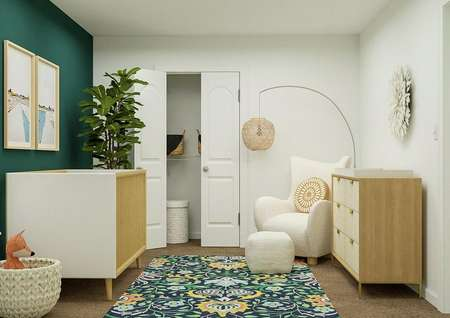 Rendering of a nursery showing a crib,   dresser, armchair and colorful rug.