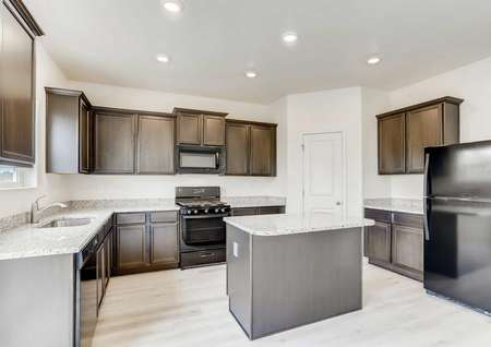 Columbia finished kitchen with black appliances, wood style floor, and granite counters and island