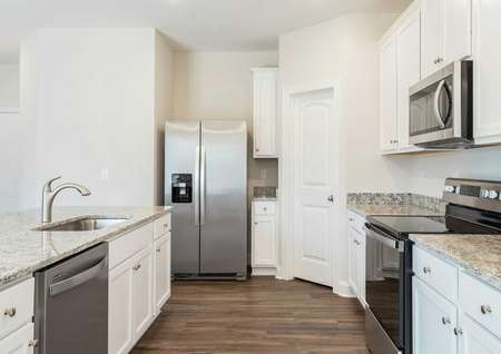 Hartford kitchen with light color granite, wood flooring, and modern appliances