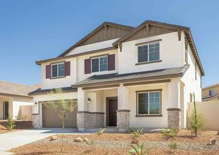 Venice completed single story home with desert landscaping, brown on white paint, and two car garage