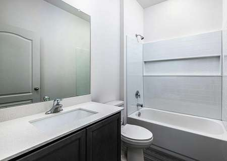 Spare bathroom with large countertop space and a soaker tub.
