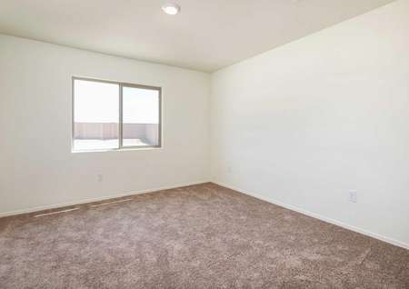 The Alamo floor plan master bedroom shown carpeted and a single window.