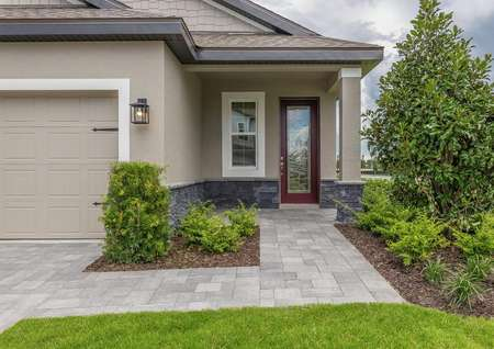 One-story floor plan with a covered entryway and a beautiful red door.