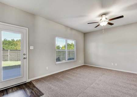 Victoria family room with ceiling fan, gray walls with white accent paint, and large glass back door