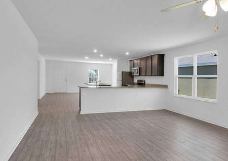 The home's entertainment space includes the family room, kitchen and dining room.