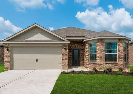 The front view of the Texoma floor plan made from brick has light-colored roofing and has a decorative garage.