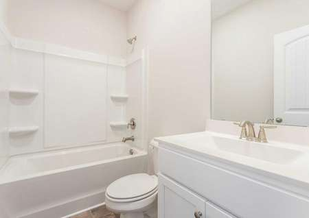Allatoona guest bath with bath/shower, white vanity housing, and large mirror