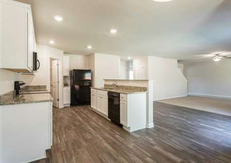 Hartford kitchen with white cabinets, granite counters, and canned lighting