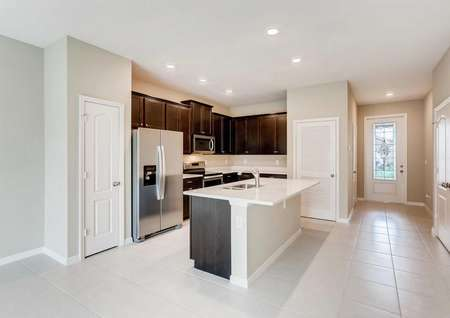 Mateo kitchen with granite counters, ceramic flooring, and wood cabinets