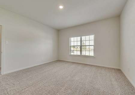 Cypress bedroom with canned light, large window with blinds, and light brown carpet