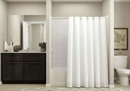 Rendering of bathroom with brown cabinet   vanity on the left, shower and tub combo in the center and toilet on the   right