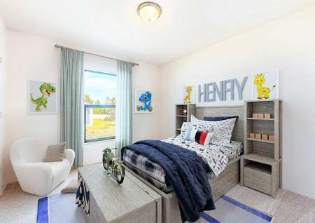 A fully furnished modelbedroom with children's paintings on the white walls, a chair and a bed set.
