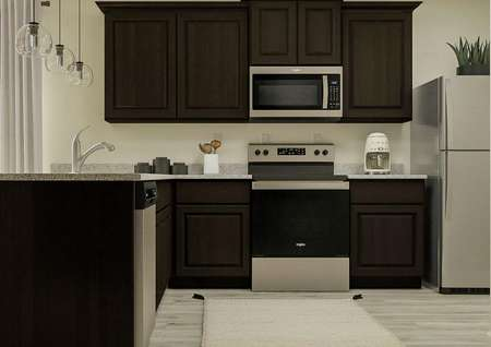 Rendering of the kitchen in the Arapaho   with dark brown cabinetry, stainless steel appliances and light wood style   flooring.