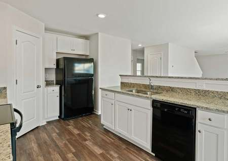 Hartford kitchen design with granite counters, island with sink and dishwasher, and brown tile floors
