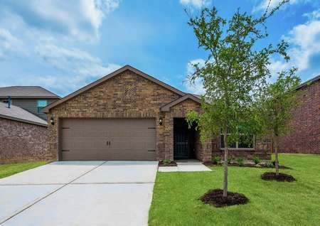 This home has an attached two-car garage and a beautiful brick exterior with lush front yard landscaping.