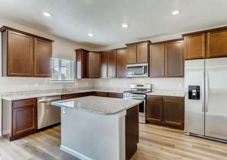 San Juan kitchen with stainless steel appliances, kitchen island, and granite counters