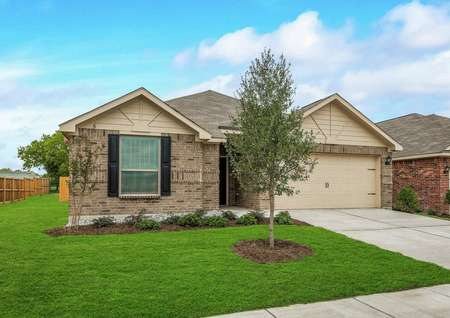 Atchison new home with one floor, brick siding, and lush green landscaped yard