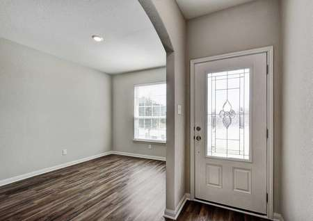 Fannin single family house front door, dining nook, and wood flooring
