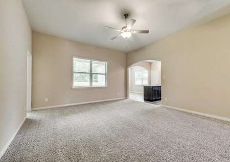 Erie open plan with carpet, ceiling fan, and white-framed windows