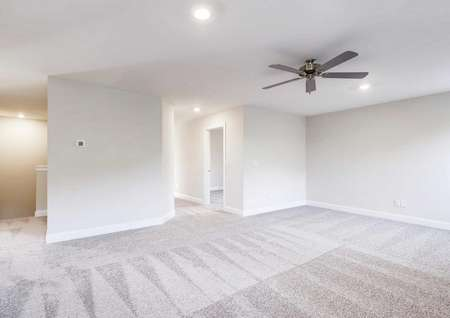 Sycamore loft with light grey carpet, recessed lighting, and ceiling fan
