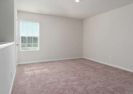 Avery floorplan room with tan carpeted floors, recessed lights, and white frame window