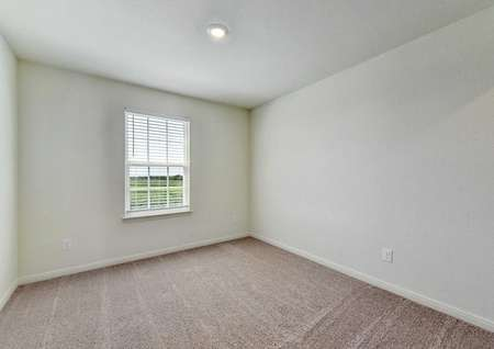 Rio bedroom with carpet floors, can light, and large white frame window