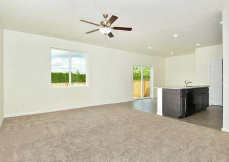 Hawthorn great room with carpet in the living room, ceiling fan, and hardwood floors in the kitchen