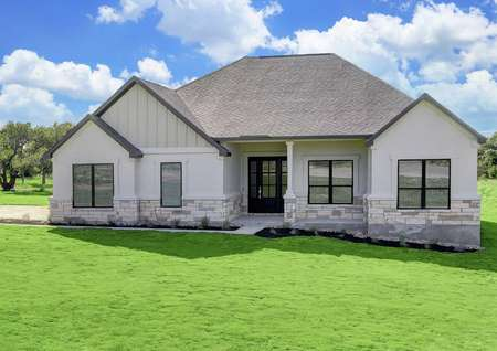 The Fairview plan is a spacious single story home with white stucco and tan stone accents.