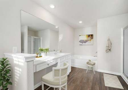Burke master bath with makeup vanity, wood floors, and canned lighting