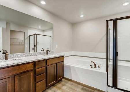 Roosevelt bathroom with two sinks, black frame shower, and modern faucets