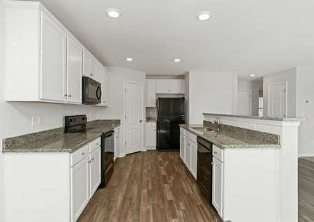 Hartford finished kitchen with wood tile flooring, granite countertops, and white-finished cabinets