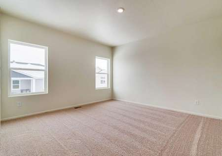 Arapaho master bedroom with 2 windows and brown carpet